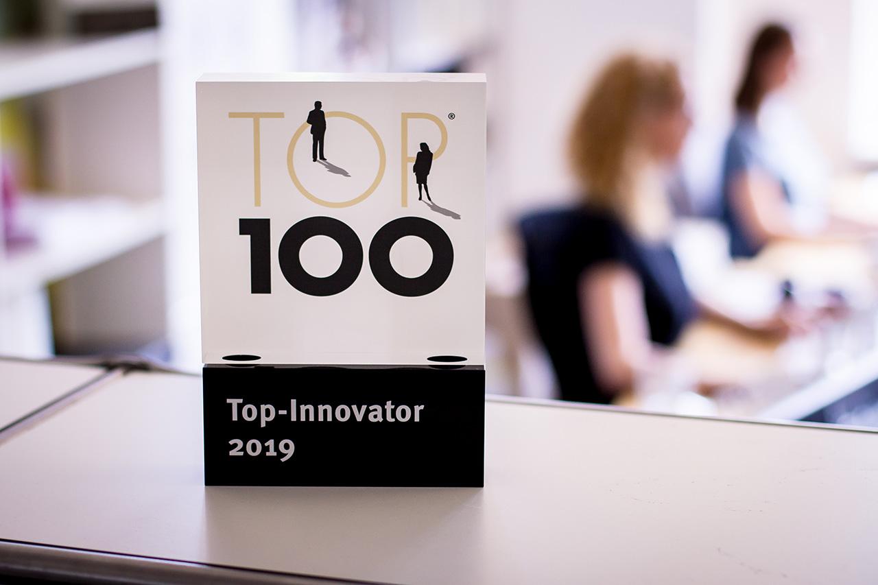 trophy top 100